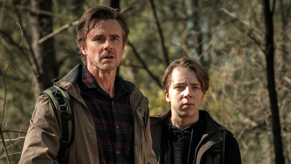 Sam Trammell and Ed Oxenbould in Reckoning