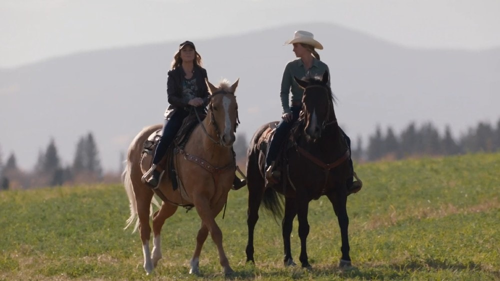 Megan Follows as Lily and Amber Marshall as Amy on a trail ride on Heartland season 14 episode 3