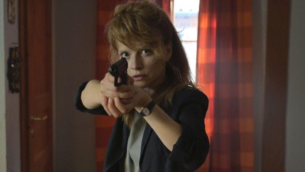 Karoline Schuch as Anne Bach on Topic's Dark Woods